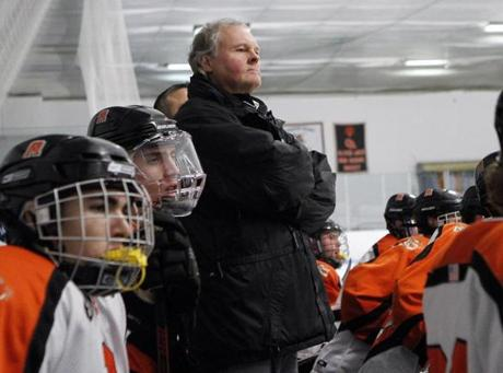 5.0.758332909_Regional_19sohockey Oliver Ames head hockey coach Jim Sullivan watches the action from the bench during the game against Franklin HIgh in Brockton, Mass., Saturday, Jan. 14, 2012. (Robert E. Klein for The Boston Globe)